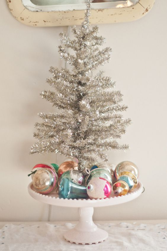 06-vintage-Christmas-display-with-colorful-ornaments-and-a-tinsel-tree
