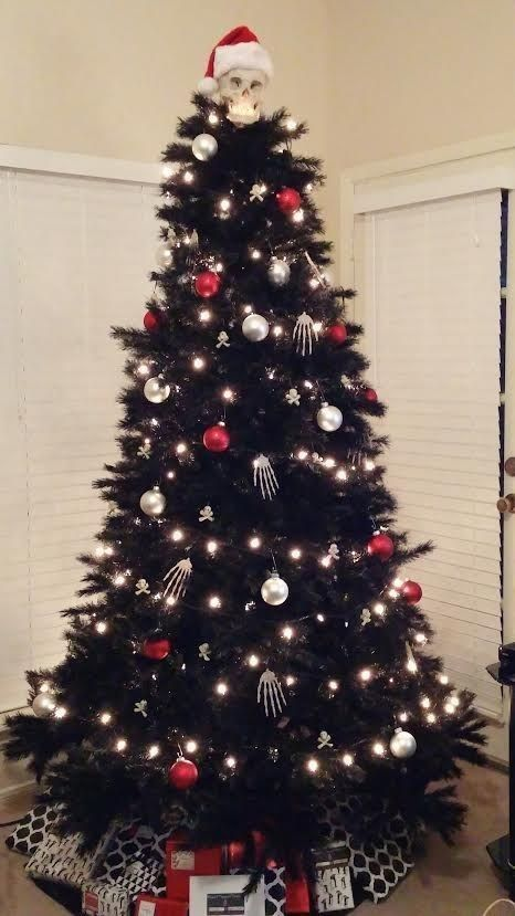 07-Nightmare-before-Christmas-inspired-black-tree-with-lights-red-and-silver-ornaments-and-skeleton-hands