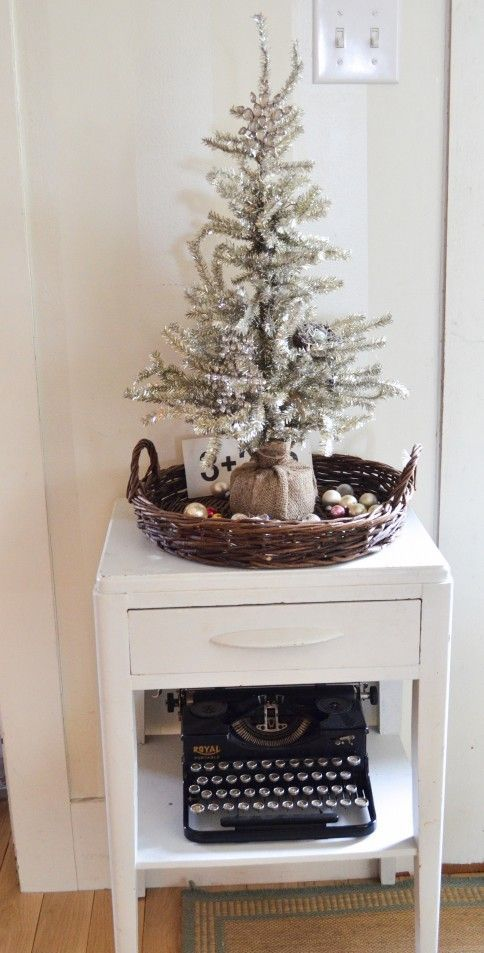 07-a-silver-tree-wrapped-with-burlap-placed-into-a-basket-with-ornaments