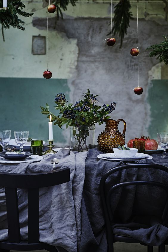 07-rustic-table-setting-with-dark-textiles-and-hanging-apples