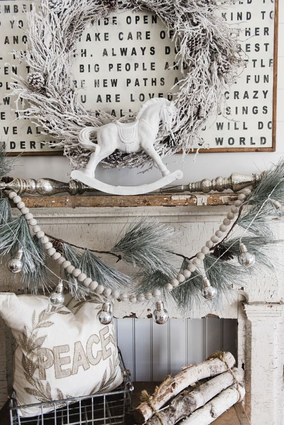 07-shabby-chic-mantel-in-off-white-a-snowy-wreath-garland-and-logs