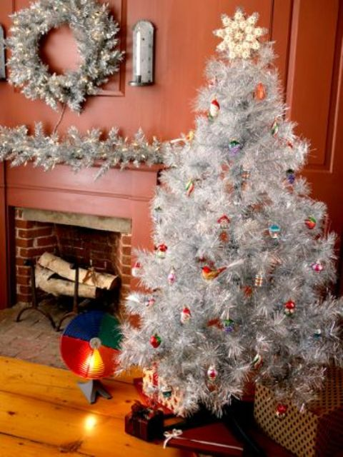 08-a-silver-tree-decorated-with-colorful-vintage-ornaments-a-silver-and-wreath-with-lights