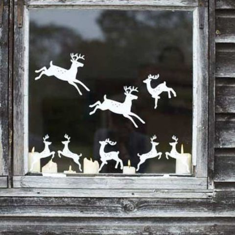 08-cut-out-reindeer-from-paper-and-attach-them-to-the-window-creating-your-own-look