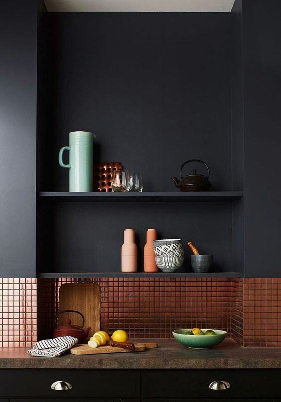 08-matte-black-kitchen-with-a-tiny-copper-tile-backsplash-looks-minimalist-and-very-chic