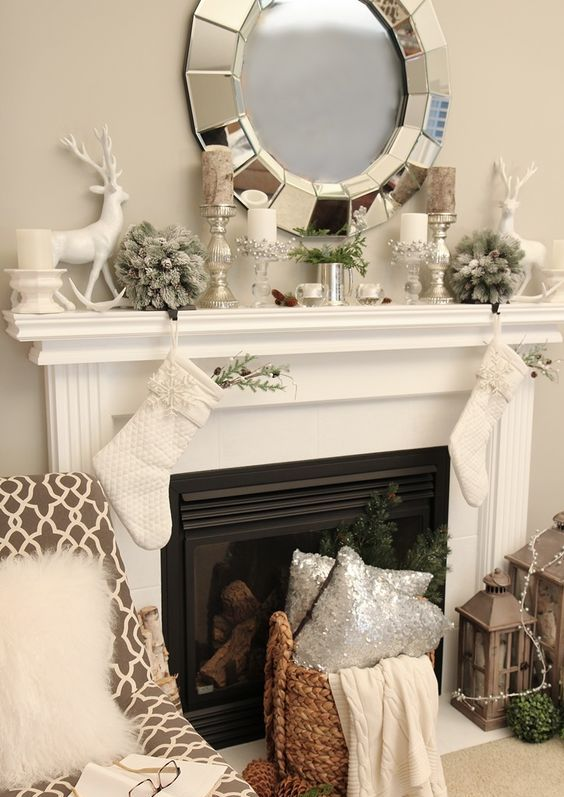 09-neutral-mantel-decor-with-silver-candle-holders-and-vases-a-deer-and-flocked-fir-balls