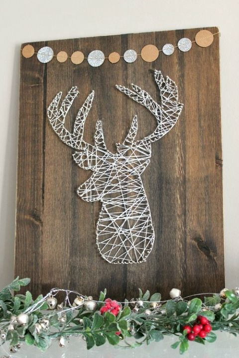 09-recycled-wooden-sign-with-a-banner-and-a-yarn-and-nail-deer