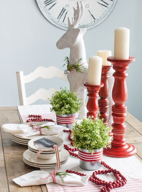 09-red-and-white-tablescape-with-candles-fresh-greenery-and-cranberries