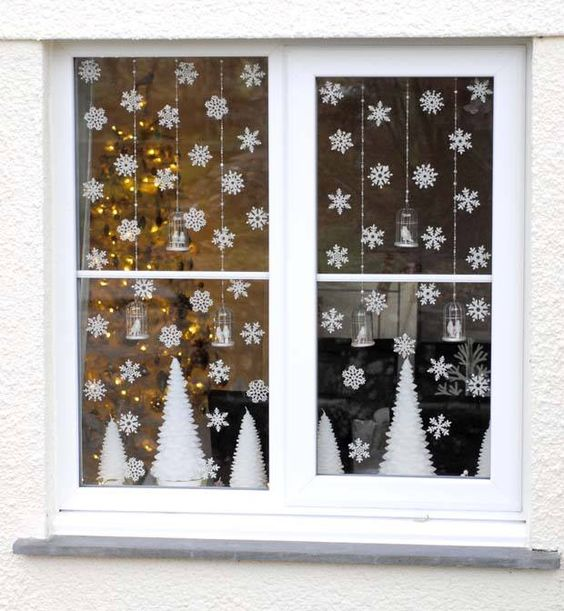 09-small-paper-snowflakes-and-white-trees-for-simple-window-decor