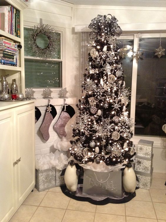 10-a-black-tree-covered-with-silver-ornaments-all-over-for-a-bold-glam-look