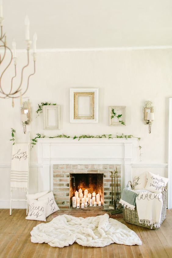 10-foliage-garland-candles-in-a-non-working-fireplace-and-blankets-in-a-basket