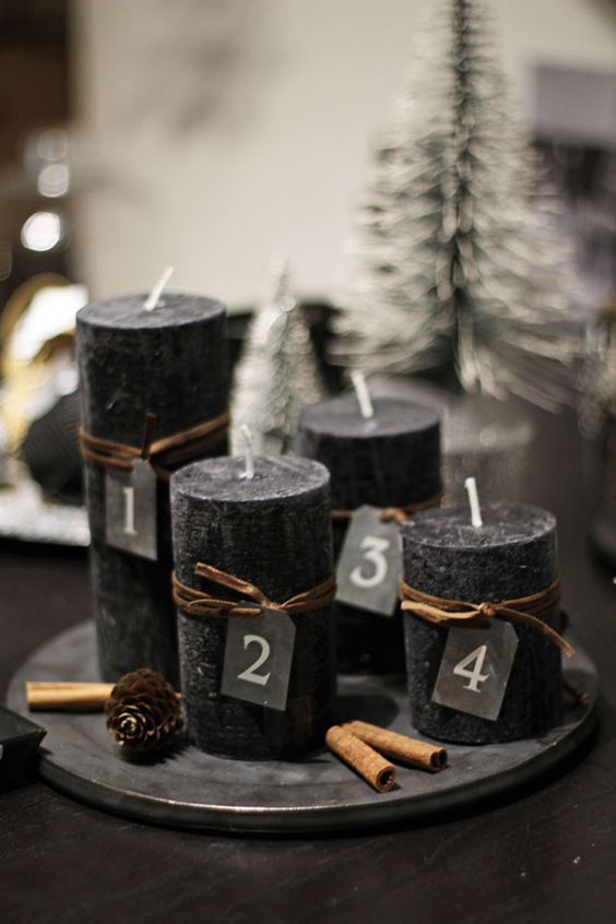 11-black-candles-on-a-dish-cinnamon-sticks-and-pinecones