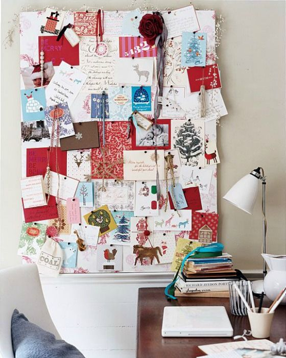 12-a-fabric-covered-board-with-all-the-cards-for-Christmas