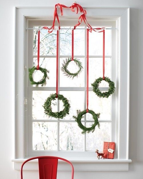 12-an-assortment-of-small-evergreen-wreaths-with-red-ribbon