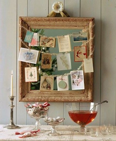 13-a-framed-mirror-with-garlands-and-hanging-photos-and-cards-on-them