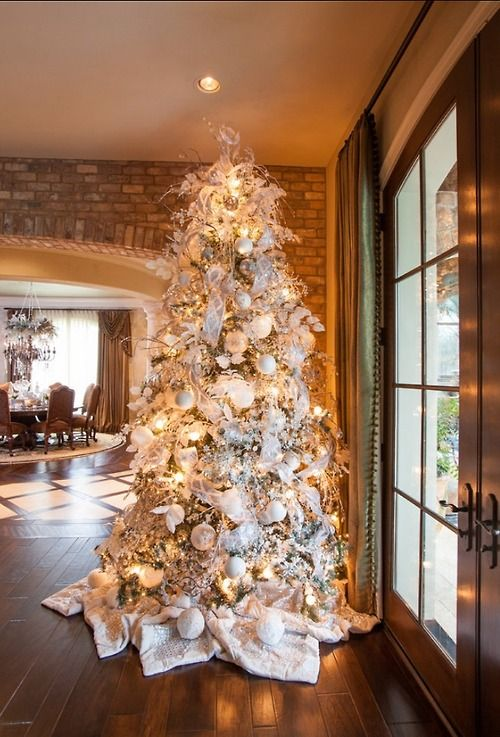 13-a-large-Christmas-tree-with-white-and-silver-decorations