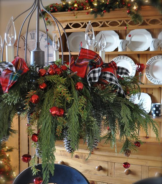 13-cute-chandelier-with-plaid-ribbon-bows-fir-branches-and-red-jungle-bells