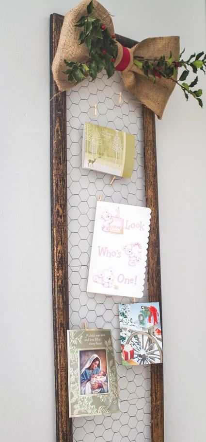 14-framed-chicken-wire-is-a-great-piece-to-hang-photos-and-cards