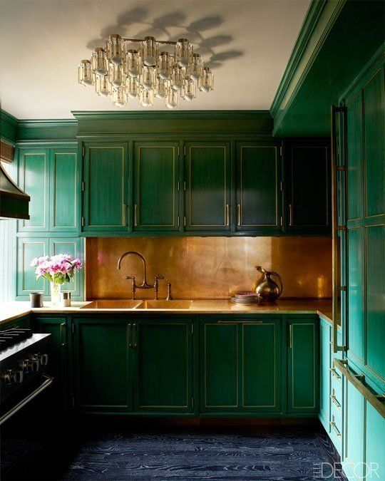 17-emerald-kitchen-with-a-copper-backsplash-and-fixtures
