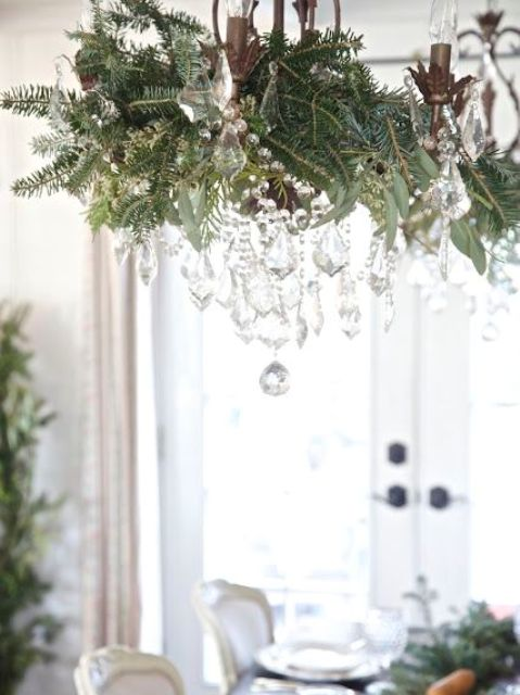 17-vintage-chandelier-decorated-with-foliage-evergreens-and-crystals