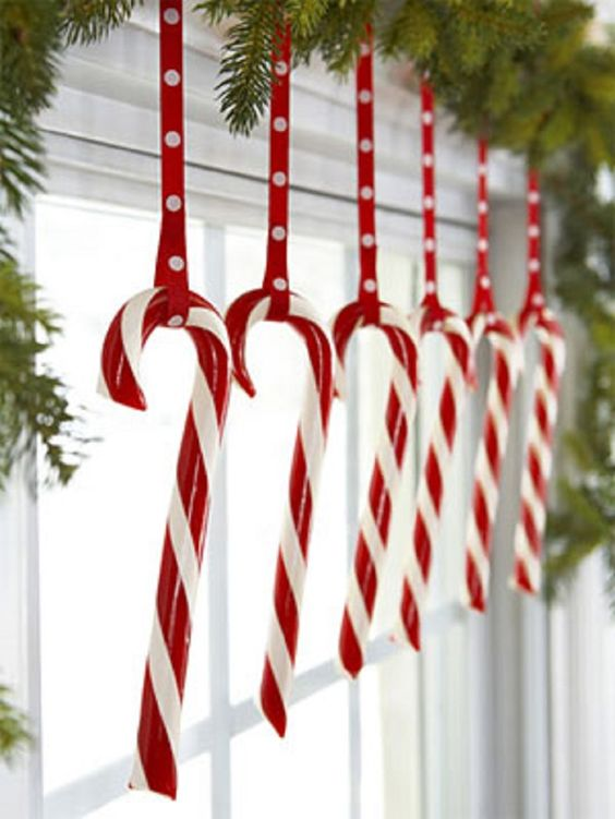 18-candy-canes-hanging-from-an-evergreen-garland-are-ideal-for-holidays