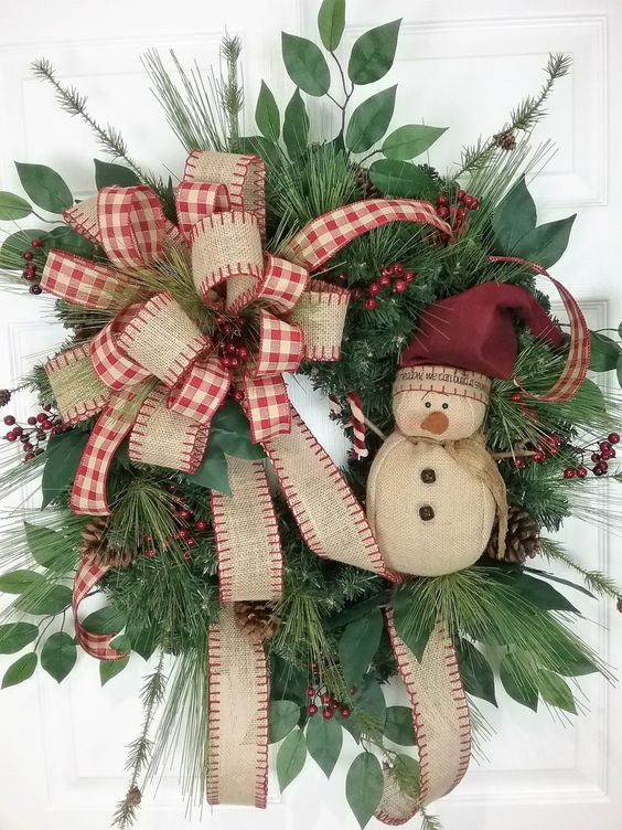 18-vintage-inspired-wreath-with-a-burlap-bow-and-a-snowman