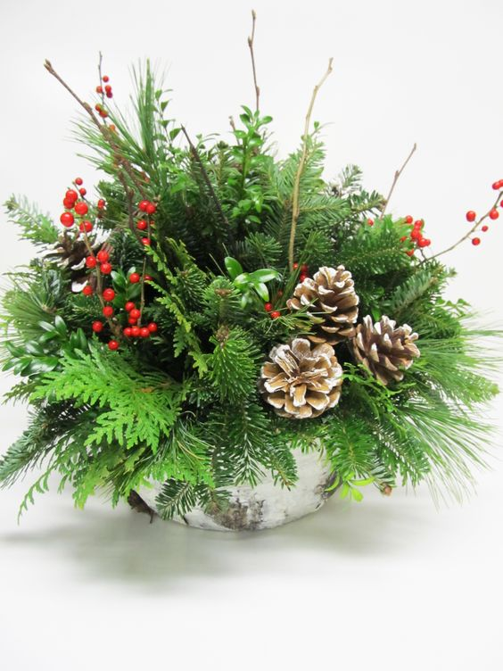 19-a-bark-wrapped-centerpiece-with-evergreens-branches-berries-and-pincones
