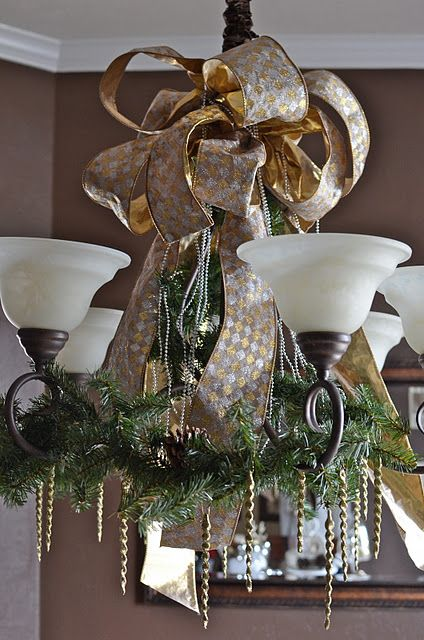 19-gold-and-silver-ribbon-evergreen-branches-with-pinecones-to-cover-a-chandelier