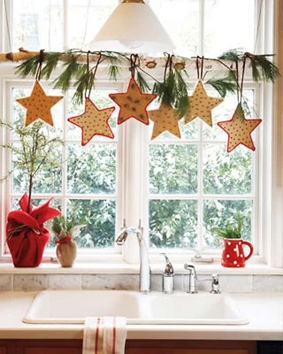 20-Christmas-star-shaped-cookies-hanging-from-a-branch