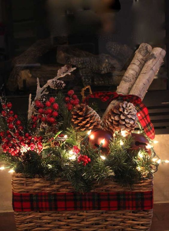 21-a-basket-with-evergreens-berries-pinecones-and-lights