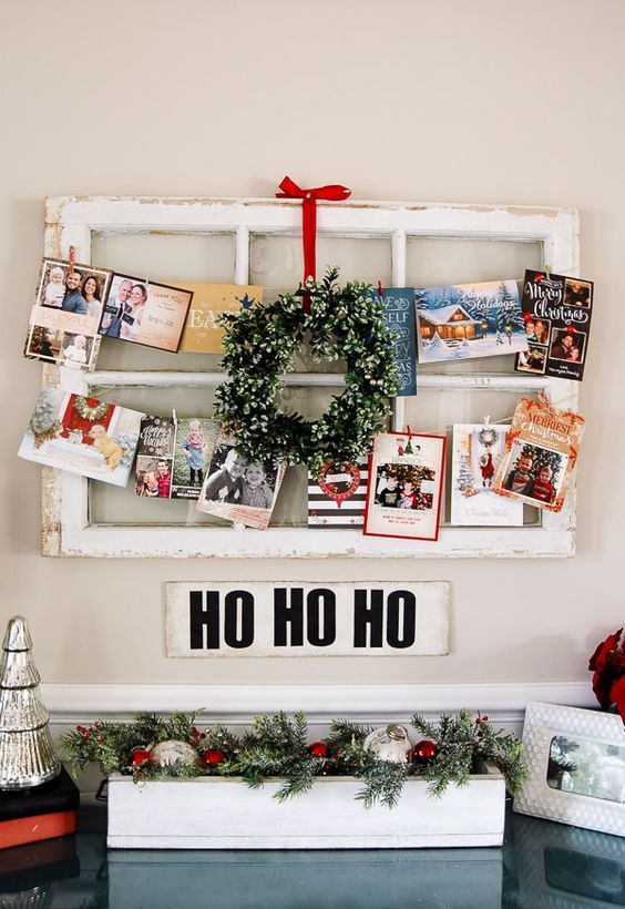 22-old-window-frame-wwith-a-mini-wreath-and-cards-and-pics-hanging