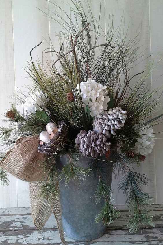 23-a-bucket-with-evergreens-snowy-pinecones-and-flowers