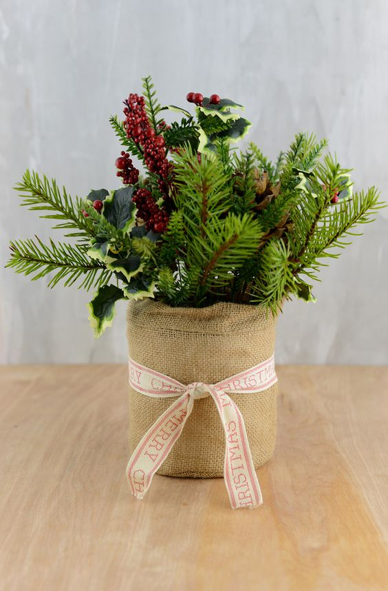24-a-burlap-wrapped-pot-with-evergreens-leaves-and-berries