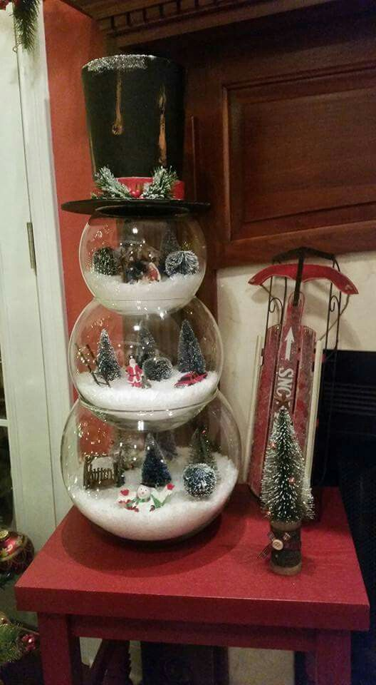 24-a-snowman-mad-eof-three-glass-terrariums-filled-with-winter-stuff-is-a-whimsy-idea