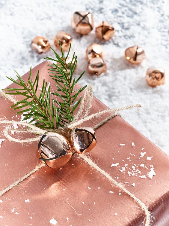 24-copper-gift-wrapping-and-jingle-bells-and-evergreen-sprigs-for-decor
