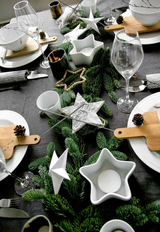 25-a-table-setting-with-faux-evergreens-star-shaped-candle-holders-and-pinecones