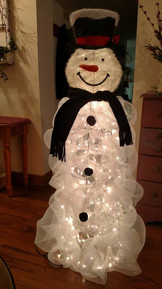 25-a-tomato-cage-lit-up-snowman-can-be-DIYed-of-lights-and-white-mesh-ribbon
