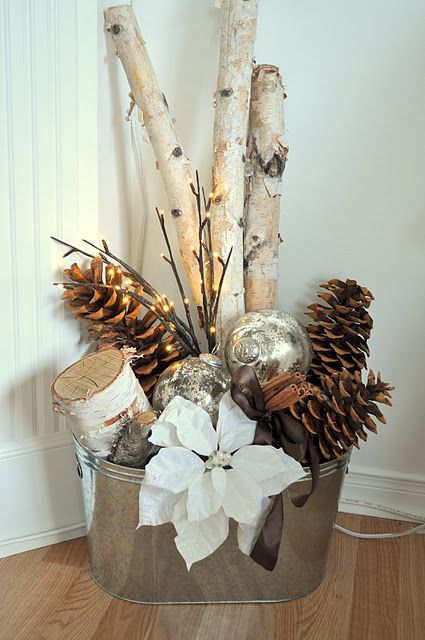 26-a-galvanized-bucket-with-branches-pinecones-ornaments-and-a-poinsettia