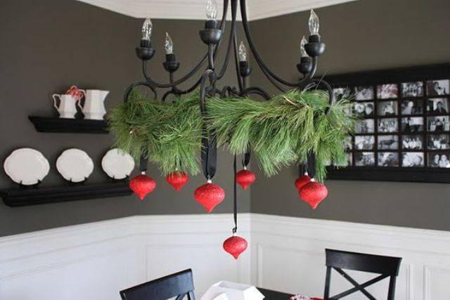 27-a-black-chandelier-contrasts-with-red-ornaments