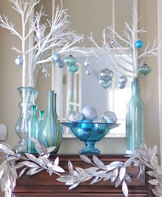 27-silver-blue-and-white-mantel-decor-with-white-branches-and-leaves