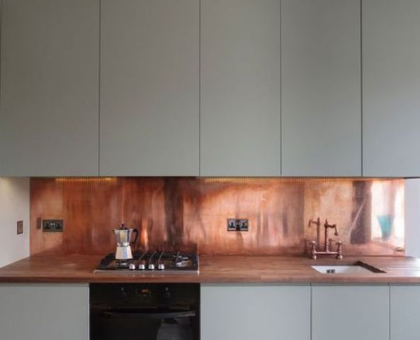 27-warm-copper-adds-a-sense-of-luxury-to-this-kitchen