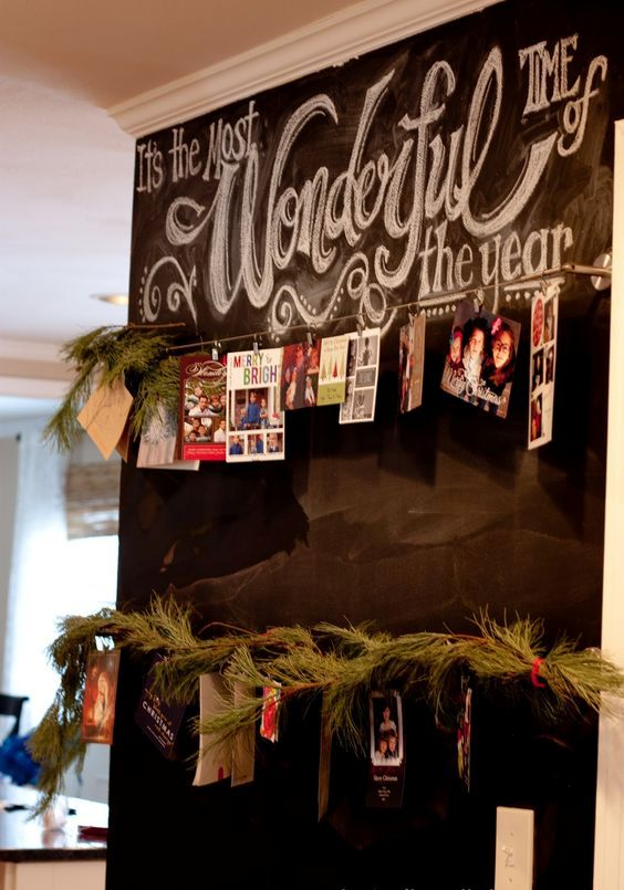 28-a-chalkboard-wall-with-wire-and-cards-hanging-on-it