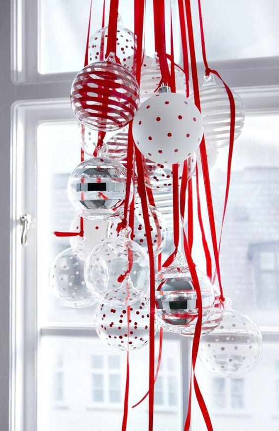 28-a-cluster-of-red-white-and-silver-ornaments-will-be-great-for-window-decor