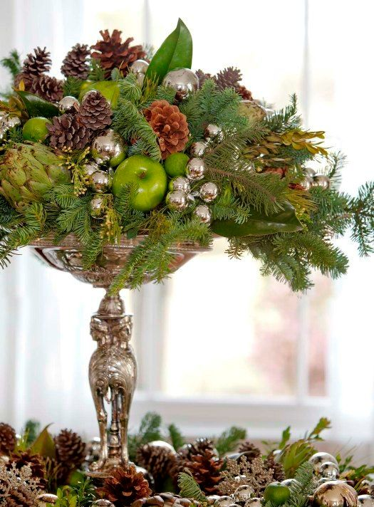 28-a-silver-stand-with-oraments-pinecones-evergreens-and-ggreen-apples