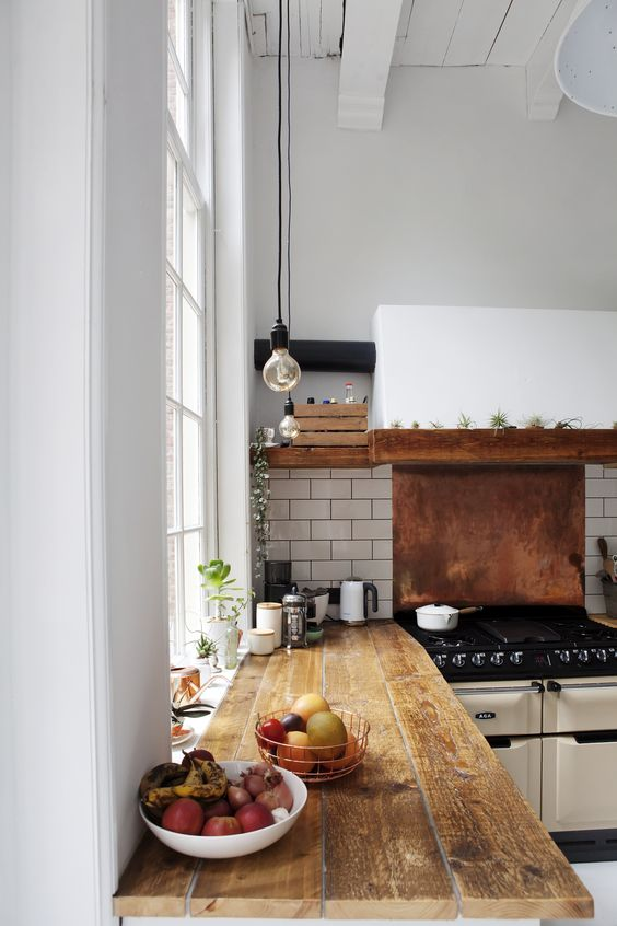 28-white-subway-tiles-and-a-copper-backsplash-for-the-cooker
