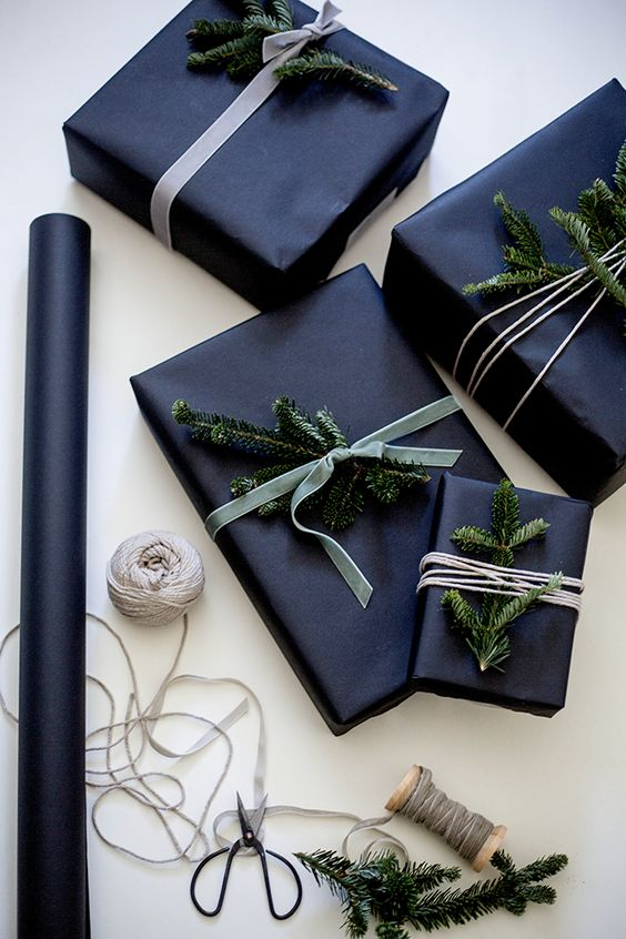 28-wrap-gifts-in-black-and-add-evergreen-sprigs-for-a-laconic-yet-festive-look