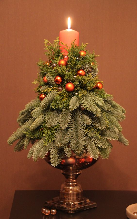 29-a-simple-small-arrangement-with-a-candles-evergreens-and-tiny-copper-ornaments