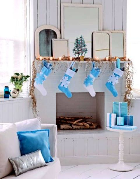 30-a-crispy-white-and-blue-Christmas-mantel-gifts-stockings-and-pillows