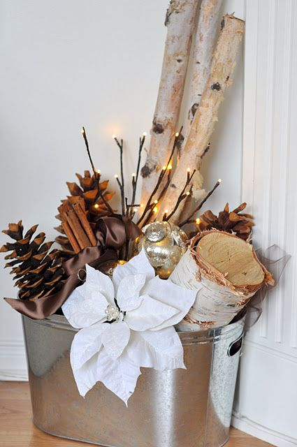 31-a-galvanized-bucket-with-logs-pinecones-lights-and-fabric