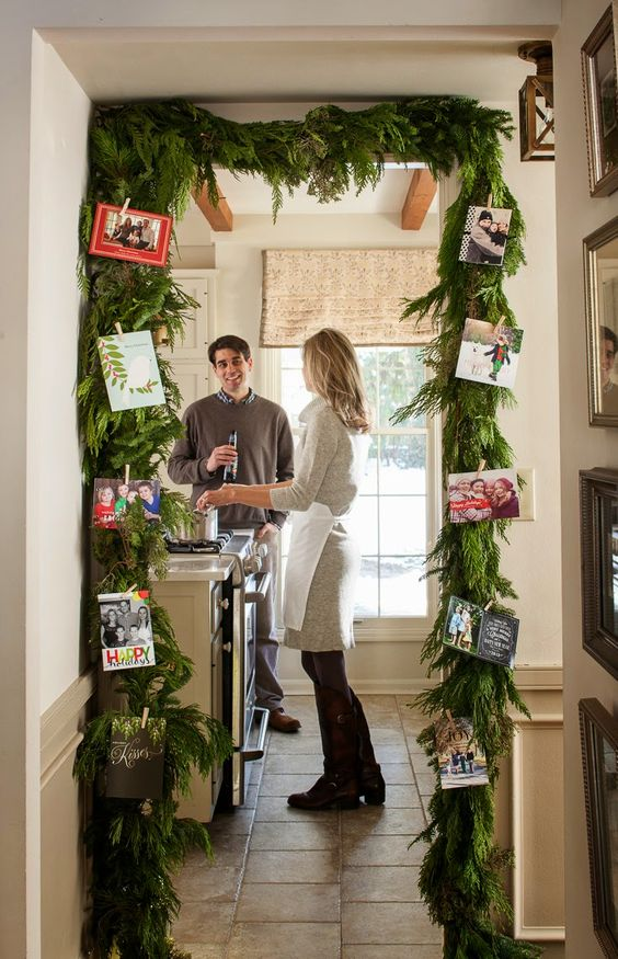 32-an-evergreen-garland-over-the-entrance-with-photos-attached