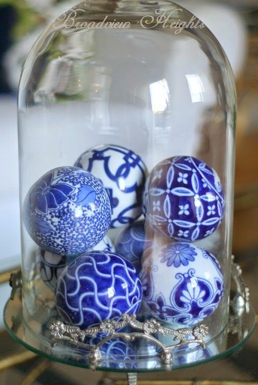32-blue-and-white-ornaments-in-a-cloche-as-a-Christmas-display